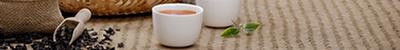 Image of tea cups and tea leaves