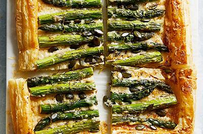 Image of Asparagus, cheese & pumpkin seed tart