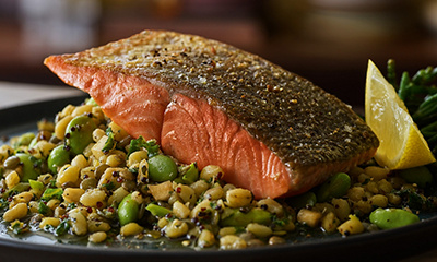 Pan-fried salmon with wheatberries, lentils and green vegetables