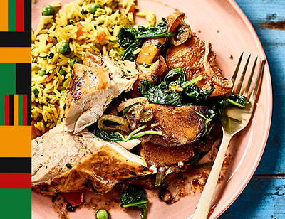 Rich seasoned rice with Caribbean-style roast chicken, roasted pumpkin & spinach