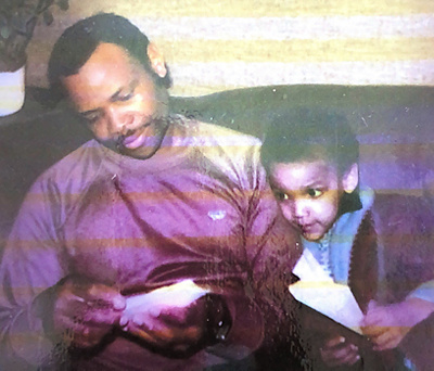 Nathan as a child and his dad
